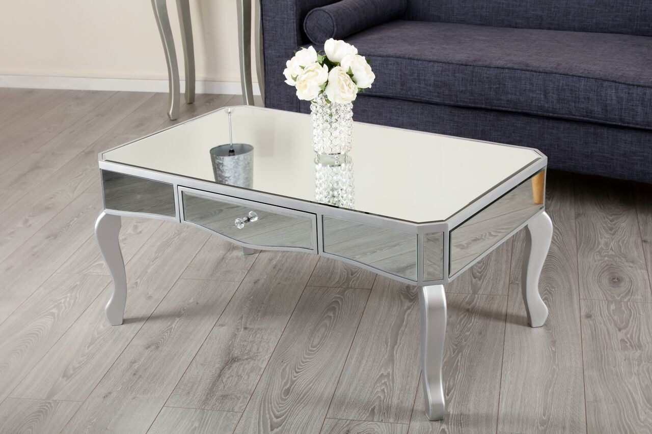 Mirrored coffee table with silver trim